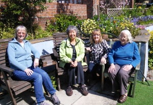 Group sitting in garden